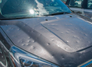 81425547 - hail damage to a car during a big storm