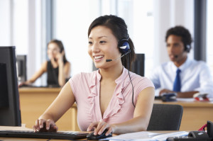42164253 - friendly customer service agent in call centre