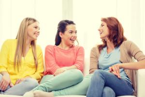 three girlfriends having a talk at home