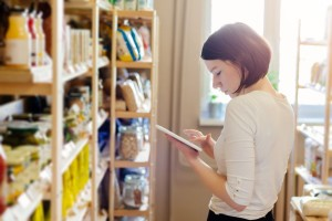 Woman owner of store with healthy food ordering products with a tablet