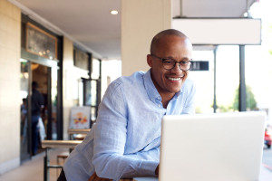 69300071 - portrait of handsome african businessman working with laptop