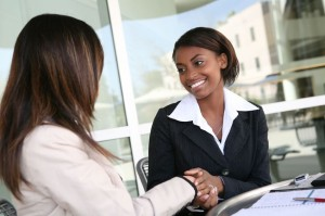 2996587 - a pretty african american business woman shaking hands